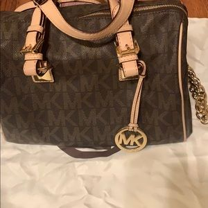 Selling a used brown and beige Michael Kors bag.